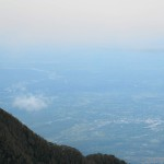 On a clear day you can see all the way to the Caribbean coast from the top of sendero mirador Volcán Turrialba National Park. It's hard to tell but there is a coastline 2/3 of the way up the photo and horizon blurs into the Caribbean