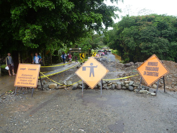 "The department of transportation sign says ""We're changing the roadmap of Costa Rica."""