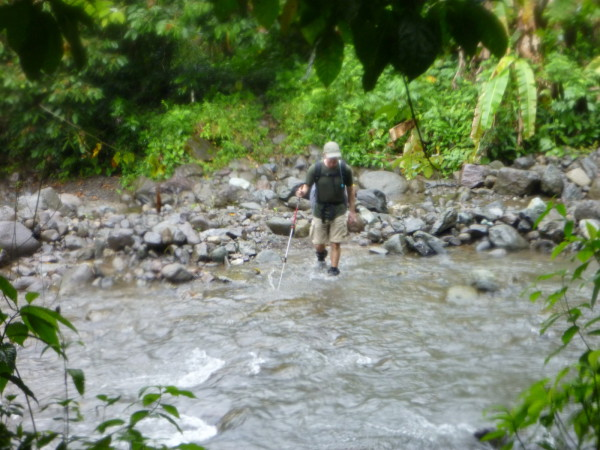"Chris crossing Quebrada Curi. The far side was the last time my boots were ""dry"" at 12:30 p.m. on day two I said the hell with it and waded across. Justin kept pulling off his boots at the crossings for a few more hours, but by the end of the second day we could all pour water out of our boots and ring out our socks."