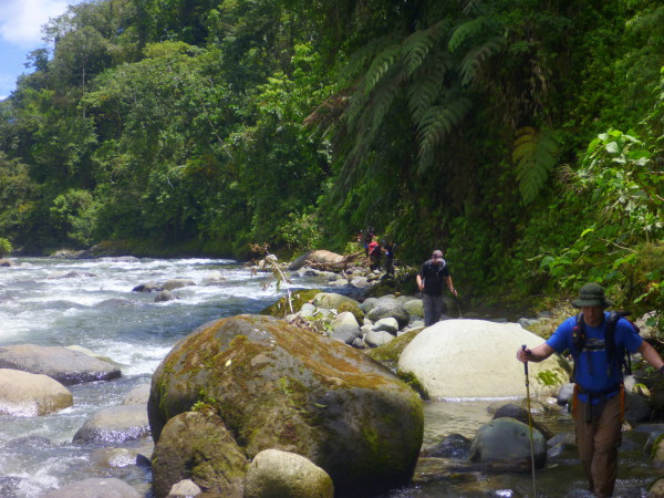 Scrambling over boulders and through knee deep water along the river's edge was a common theme on day three