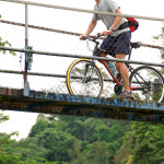Biking Over the Quebrada Blei on a suspension bridge near Suretka