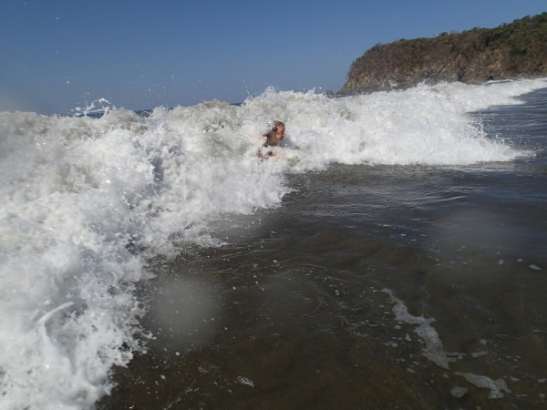 Boogie boarding in the whitewater. In front of Sand Dollar Cove, Playa San Miguel central Nicoya Peninsula