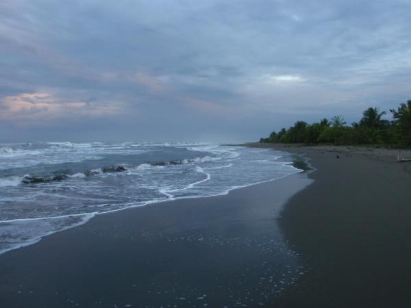 Stormy sunrise over Playa Westfalia, Caribbean Coast
