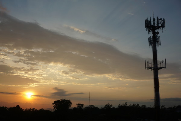 Cell phone tower at sunset