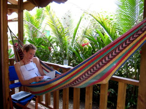 Sue hard at work summarizing the day's research in a hammock on the porch of Lodge Arena Tropical in Manzanillo