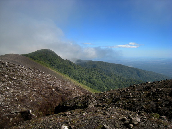 The trail along the crater rim of Rincón de la Vieja disappears into the distance.