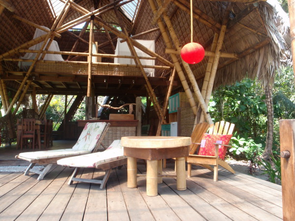 "One of the beach ""houses"" with a completely open air design and mosquito nets over the two beds upstairs. Privacy is provided by isolation and a divider down the middle of the ""bedroom"""
