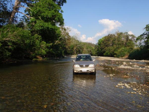 Suzuki fording a river