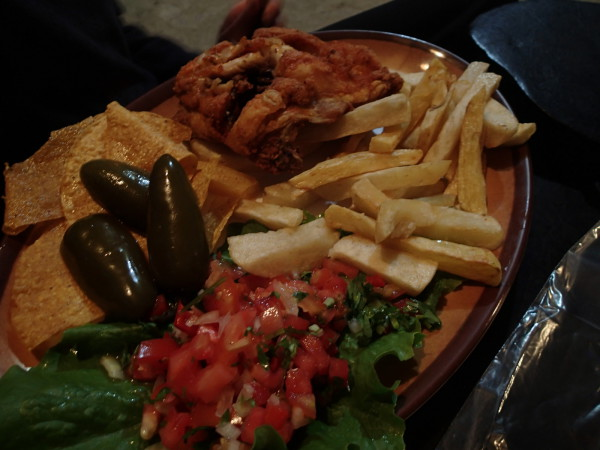Trout, fries, peppers and tomato salad