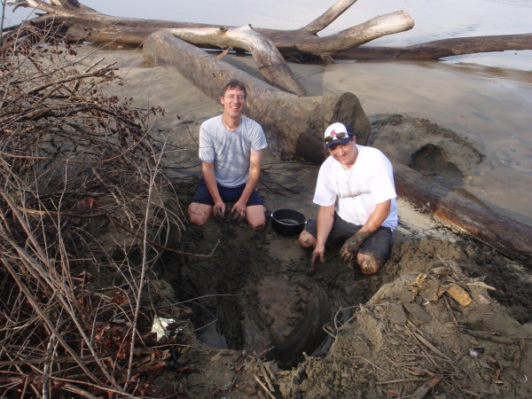 Justin and Ray playing in the sand digging up a turtle skeleton