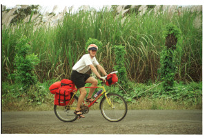 Cycling past sugar cane