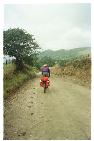right: riding down the hill from Monteverde towards Juntas and Canas