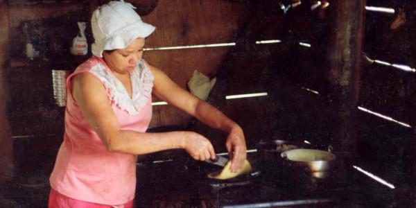 Flipping tortillas wood stove