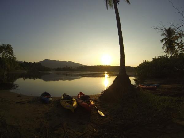 Kayaks at sunrise on laguna Javilla behind playa San Miguel, Nicoya Peninsula Costa Rica