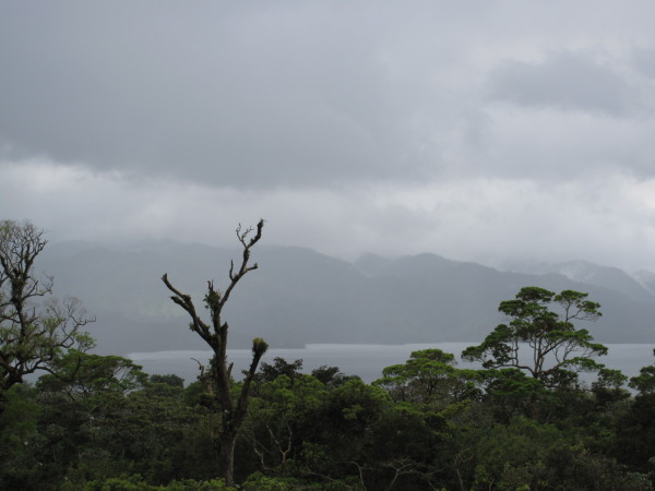 View back towards the lake as a storm moves in - from Sendero Coladas Arenal Volcano National Park