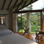Floor to ceiling glass looks towards Tenorio Volcano Tenorio Lodge