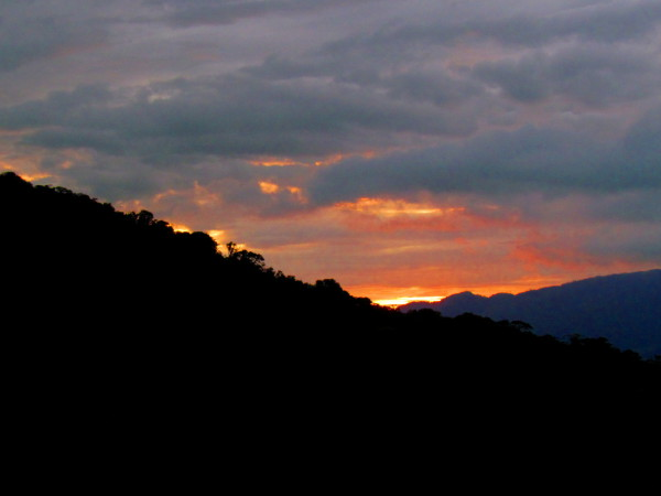 Sunset behind the lower slopes of Tenorio to the left and Miravalles to the right with the Bijagua valley between