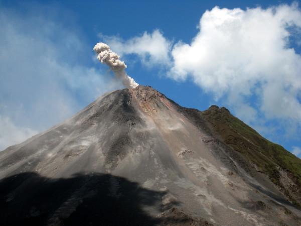 Arenal volcano puffs smoke
