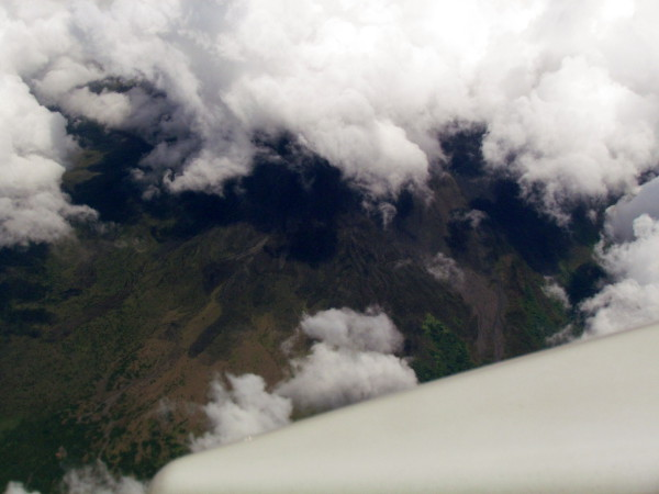 Arenal Volcano from 18,000 feet. The top is covered in clouds but the lava fields are in view at the center of the frame. From a commercial jet on the way from the U.S. to SJO