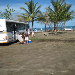 Day trippers unload at Playa Manzanillo Costa Rica - wekend buses transport Josefinos to the coast for a few hours of fun in the sun. It's a long haul (4 - 6 hours each way depending on traffic) for a quick visit.