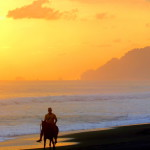 Horse and rider on playa Madrigal west of Carate on the Pacific coast of the Osa peninsula