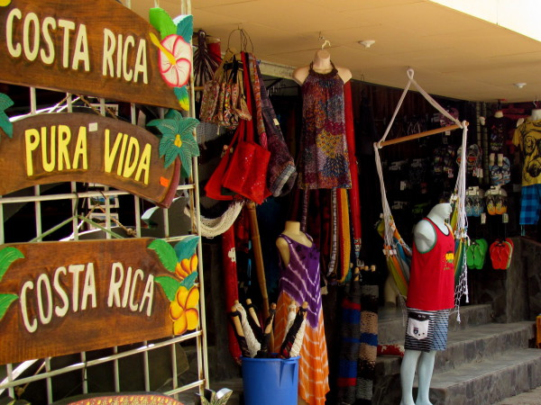 Costa Rica...Pura Vida...Costa Rica...Pura Vida the signs are the mantra on the boardwalk downtown Tamarindo Beach