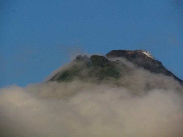 Arenal volcano skirted with clouds at sunrise