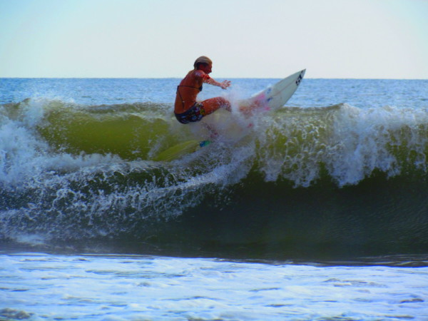 Surfing playa Hermosa national wildlife refuge south of Jaco on the central Pacific coast