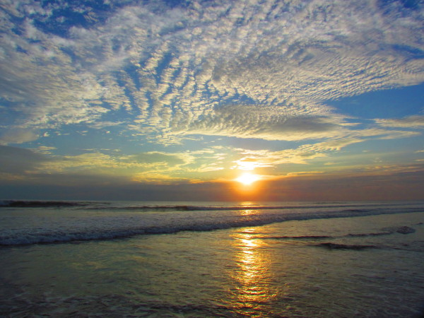 Playa Hermosa sunset with striated clouds