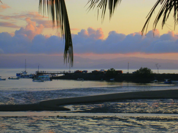 Muelle Puerto Jimenez at sunrise. Everyone gathers on the dock to catch the first boat to Golfito