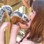 Vivi holding a squirrel at the wildlife rescue in Carrillo beach