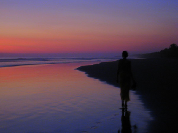 Sue leaving footprints at sunset on Playa Palo Seco south of Parrita, central Pacific coast