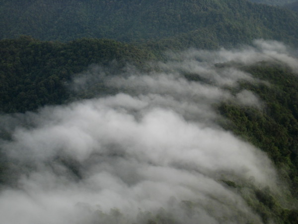 Clouds flowing over the mountain ridges