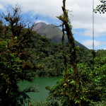 Arenal volcano rises above the rainforest surrounding the rim of the crater of Cerro Chato