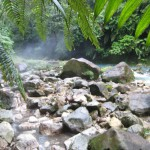 Steam rising off the hot springs with the turquoise Rio Celeste in the background