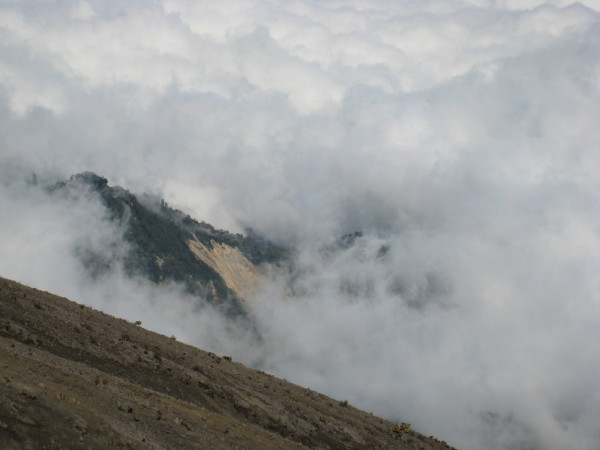 Irazú Volcano would be capped with rainy paramo and cloud forest if the toxic gases and volcanic activity didn't turn the peak into a moonscape