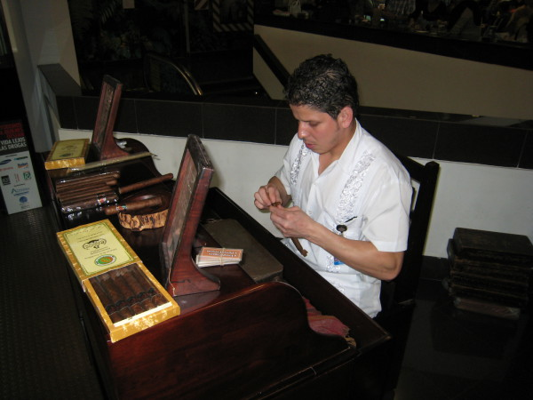 One of the more popular souvenirs in the airport are hand rolled (while you wait if you'd like) cigars using Cuban tobaccos
