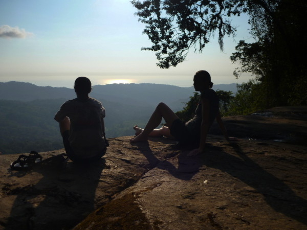Watching the sunset over the Pacific Ocean from the top of Diamante waterfall, Dominical central Pacific