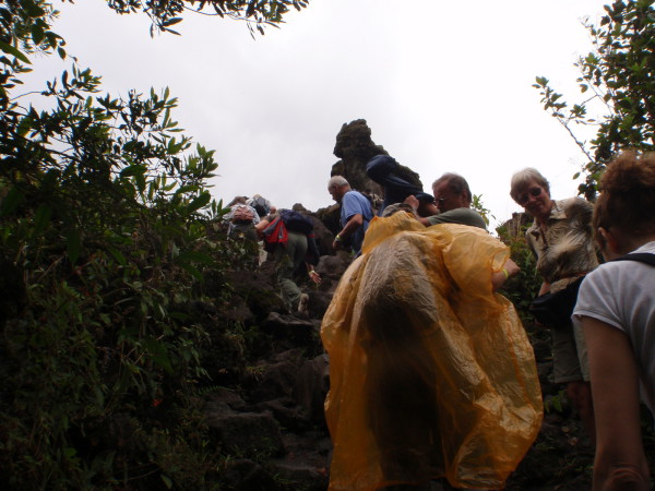 Tour Group climbing onto the lava flow on the Sendero Coladas.