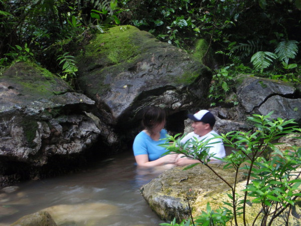 In the hot springs along the Rio Celeste in the rain. Tenorio national park northern Guanacaste Costa Rica