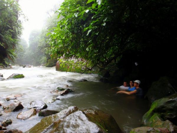 In the natural hot springs in the rain - alongside the Rio Celeste in Volcan Tenorio National Park