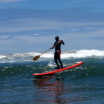 Suresh trying out his new Stand Up Paddle Board (SUP) in the surf at Playa San Miguel