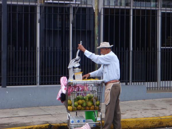 Fresh squeezed orange juice street vendor