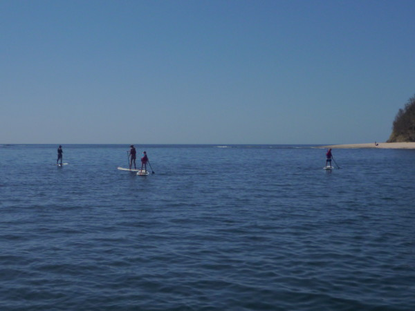 Stand up paddling to the island in Samara bay