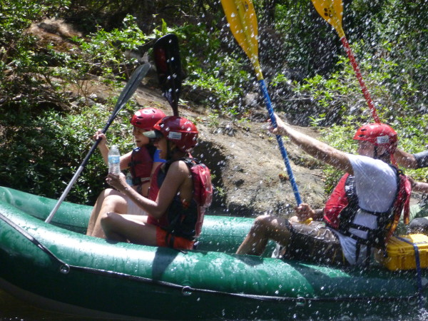 A paddle splashing waterfight on the Rio Tenorio