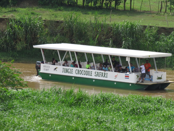 Crocodile tour boats come up the Tarcoles river