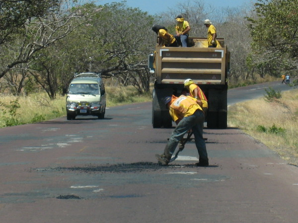 Patching potholes on a highway in Guanacaste Costa Rica