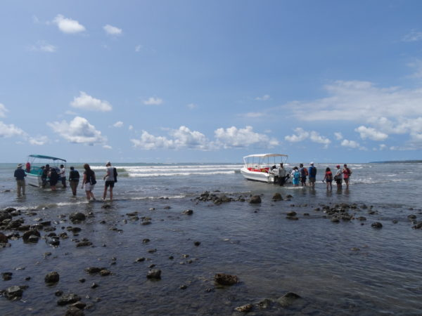 Corcovado visitors loading onto boats near Sirena station, Osa Peninsula, Costa Rica